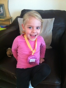 Ava's pink medal