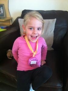 Ava's pink medal